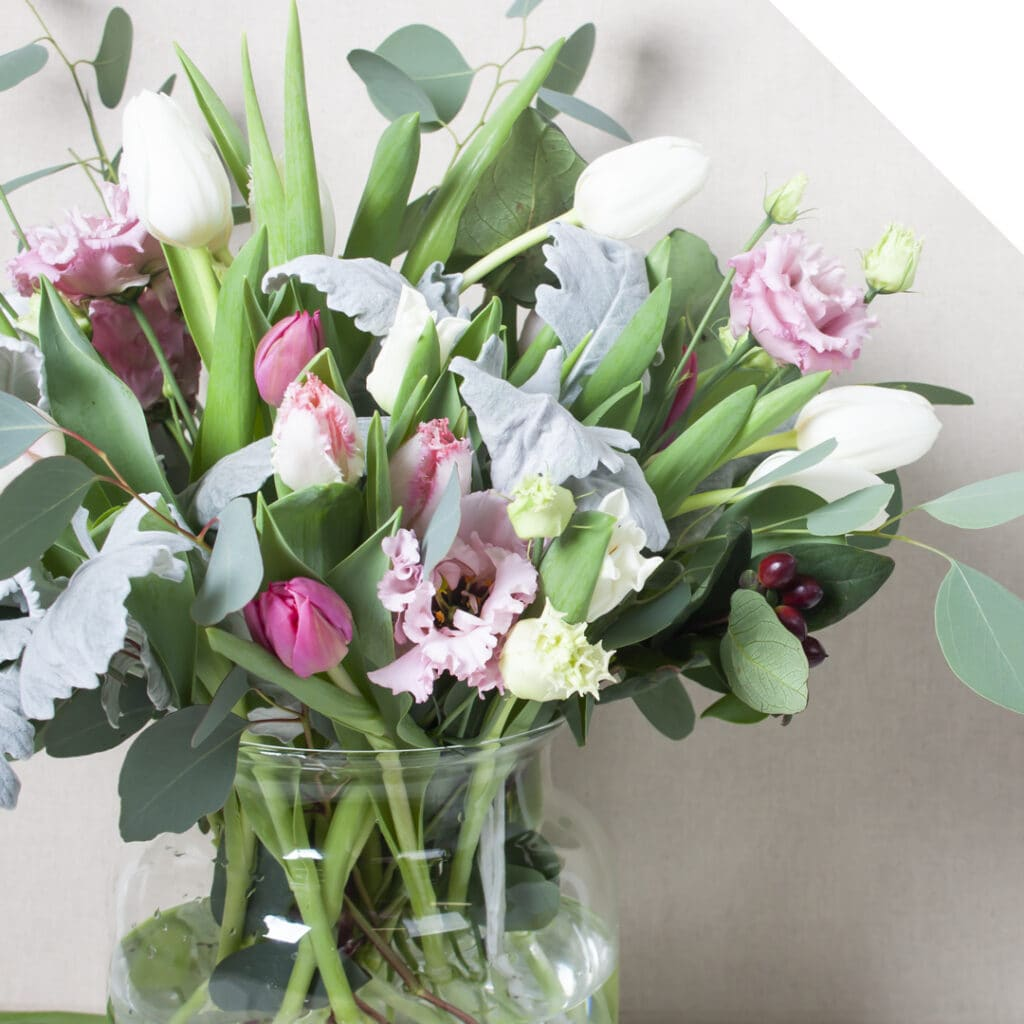 A romantic centerpiece with tulip design in a vase
