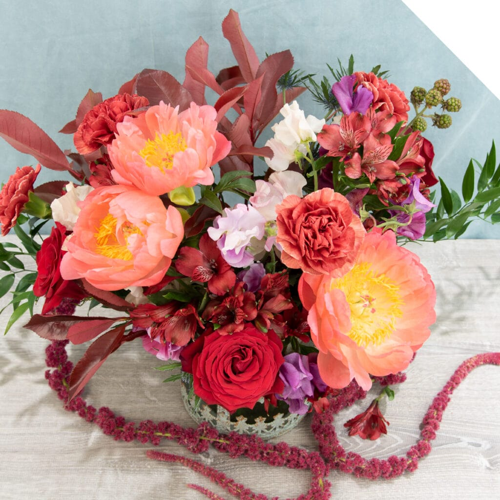 Centerpiece with various red flowers