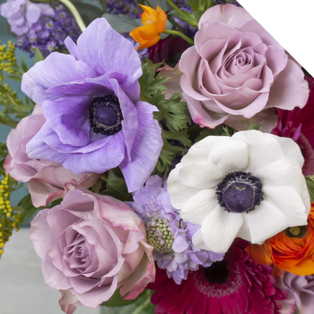 Spring bouquet with Anemone, Tulips, Roses and Eucalyptus