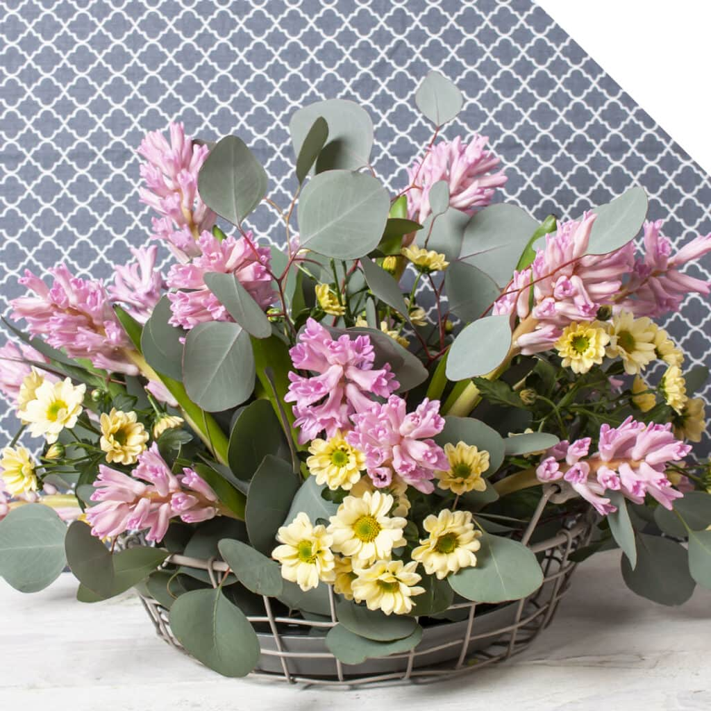 Picture of a rural centerpiece with pink Hyacinths